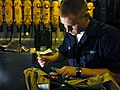 US Navy 071207-N-1688B-232 Damage Controlman Fireman Dominic Green performs regular maintenance to the self contained breathing apparatus aboard the Nimitz-class nuclear-powered aircraft carrier USS Harry S. Truman (CVN 75).jpg