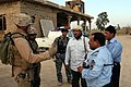 US Navy 071229-M-4746J-063 2nd Lt. Christian Schmidle, assigned to I Co., 3rd Battalion, 3rd Marine Regiment, speaks with Iraqi policemen in Zaidon, Iraq.jpg