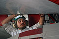 US Navy 080103-N-2880M-077 Aviation Structural Mechanic 3rd Class Jahasiel Altamirano, attached to the Seahawks of Carrier Airborne Early Warning Squadron (VAW) 126 works to secure the port flap of an E-2C Hawkeye.jpg