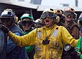 US Navy 080723-N-2638R-008 Aviation Boatswain's Mate (Handling) 1st Class Mark Rodriguez, from Sequin, Texas, shouts out commands to Sailors on his hose teams during flight deck drills aboard the aircraft carrier USS Kitty Hawk.jpg
