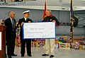 US Navy 081216-N-5617R-047 Capt. Michael Kelly, commanding officer of Fleet Readiness Center Southwest, presents toys and a check to retired Gunnery Sgt. R. Lee Ermey to benefit the Marine Corps Reserve Toys for Tots program.jpg