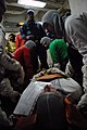 US Navy 090416-N-5251G-045 Medical training team member Hospital Corpsman 1st Class Nikki Craig watches over a response team as they lift a simulated electrical shock victim during a general quarters drill aboard the aircraft c.jpg