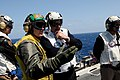US Navy 090416-N-7730P-063 Lt. Cmdr. Kevin Rice, a shooter aboard the aircraft carrier USS Ronald Reagan (CVN 76), explains flight operations to Adm. Sir Jonathon Band, First Sea Lord and Chief of Naval Staff of the Royal Navy.jpg
