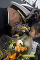 US Navy 090419-N-1251W-112 Cmdr. Richard Dromerhauser, commanding officer of the USS Fitzgerald (DDG 62), receives a bouquet of flowers from a child after Fitzgerald's arrival in the port city of Qingdao.jpg