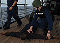 US Navy 090430-N-0046R-014 Ship's Serviceman Seaman Jimmy Roberts apprehends a role-player depicting a suspected terrorist during an anti-terrorism force protection drill.jpg