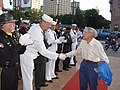 US Navy 090916-N-2888Q-002 Chief petty officer (Sel.) Timothy Link, assigned to Navy Operational Support Center Detroit, shakes hands with a World War II veteran.jpg