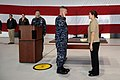 US Navy 091202-N-9818V-027 Master Chief Petty Officer of the Navy (MCPON) Rick West administers the reenlistment oath to Aviation Warfare Systems Operator (Mechanical) 1st Class Deborah Spinner during his visit to Air Test and.jpg