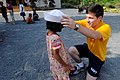 US Navy 100220-N-8335D-022 Mineman 3rd Class Jmyle Koretz, assigned to the mine counter-measures ship USS Patriot (MCM 7), gives a child his.jpg