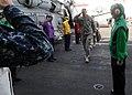 US Navy 100304-N-4236E-120 Lt. Gen. David M. Rodriguez, commander of International Security Assistance Force Joint Command, walks through side boys as he arrives on the Nimitz-class aircraft carrier USS Dwight D. Eisenhower (CV.jpg
