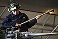 US Navy 100406-N-7364R-087 Aviation Machinist's Mate 3rd Class Jason McConell uses a torque wrench on the main rotor head of an MH-60S Sea Hawk helicopter.jpg