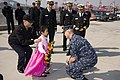 US Navy 101110-N-4366B-057 Cmdr. Steve Mack, commanding officer of the Virginia-class attack submarine USS Hawaii (SSN 776), is greeted by the daug.jpg
