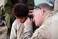 US Navy 101122-M-3860M-147 Chief Hospital Corpsman David Worrell, the leading chief petty officer for 3d Battalion, 25th Marine Regiment, treats an.jpg