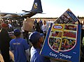 US Navy 101202-N-9712C-004 Volunteers from local organizations work with military personnel to offload toys delivered by Fat Albert, a C-130 Hercul.jpg