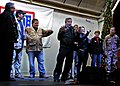 US Navy 101217-N-6266K-252 omedian Robin Williams is joined on stage by fellow United Service Organizations, entertainers, and Chairman of the Join.jpg