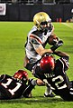 US Navy 101223-N-1722W-252 U.S. Naval Academy running back Bo Snelson (^23)is stopped by San Diego State University defensive backs Brandon Davis (.jpg