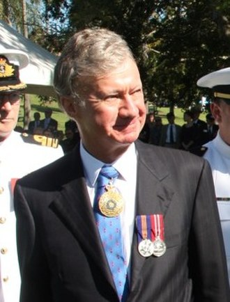 Governor of Queensland - Image: US Navy 110507 N 1X994 001 Members of the U.S. 7th Fleet Band are inspected by acting Governor and Chief Justice of Queensland the Honorable Paul d (cropped)