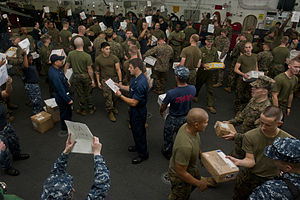 US Navy 111212-N-DX615-007 Sailors and Marines sort mail aboard the amphibious assault ship USS Makin Island (LHD 8).jpg