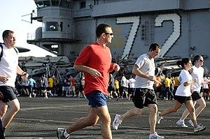 US Navy 120215-N-DH811-193 Sailors participate in a 5-kilometer fun run on the flight deck of the Nimitz-class aircraft carrier USS Abraham Lincoln.jpg