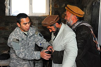 Basic airway management - US medic teaches the abdominal thrusts to Afghans