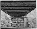 VIEW OF UNDERSIDE OF DECK SHOWING SOUTH ABUTMENT - Oak Knoll Park Bridge, Oak Knoll Park, Massillon, Stark County, OH HAER OHIO,76-MASS,1-5.tif