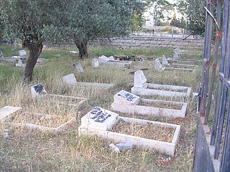 """Persecution of Christians in the modern era - A vandalized Christian graveyard in Bethlehem. The text says """"Death to Arabs"""" in Hebrew."""