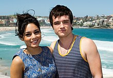 Josh Hutcherson in a striped blue tank top and Vanessa Hudgens in a blue dress.