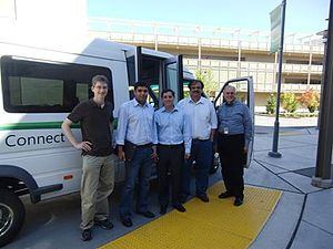 Victor Bahl - U.S. Federal Communications Commission chairman Julius Genachowski (middle) in front of the shuttle connected to the first white space radio network (Microsoft Research Redmond campus, Saturday, August 14, 2010).  Also pictured is Microsoft's Chief Research and Strategy Officer Craig Mundie (far right).
