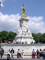 Victoria Memorial was created by the sculptor Sir Thomas Brock in 1911 and erected in front of the main gates at Buckingham Palace on a surround was constructed by the architect Sir Aston Webb.