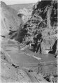 View showing conditions at outlet portals of Diversion tunnels Nos. 3 and 4 after diversion. Temporary backwash dike... - NARA - 293769.tif