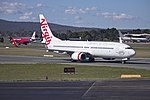 Virgin Australia (VH-YFC) Boeing 737-81D (WL) taxiing to the terminal at Canberra Airport.jpg