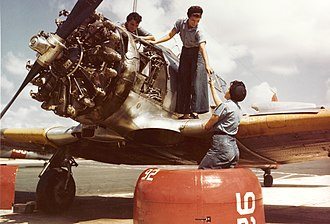 Naval Air Station Whiting Field - Female mechanics working on a Texan trainer, c. 1943