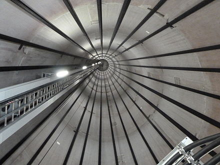Inside view of a wind turbine tower, showing the tendon cables. WKA spannglieder.jpg