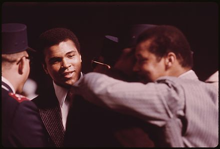 Ali in 1974 WORLD HEAVYWEIGHT BOXING CHAMPION MUHAMMAD ALI, A BLACK MUSLIM, ATTENDS THE SECT'S SERVICE TO HEAR ELIJAH MUHAMMAD... - NARA - 556247.jpg