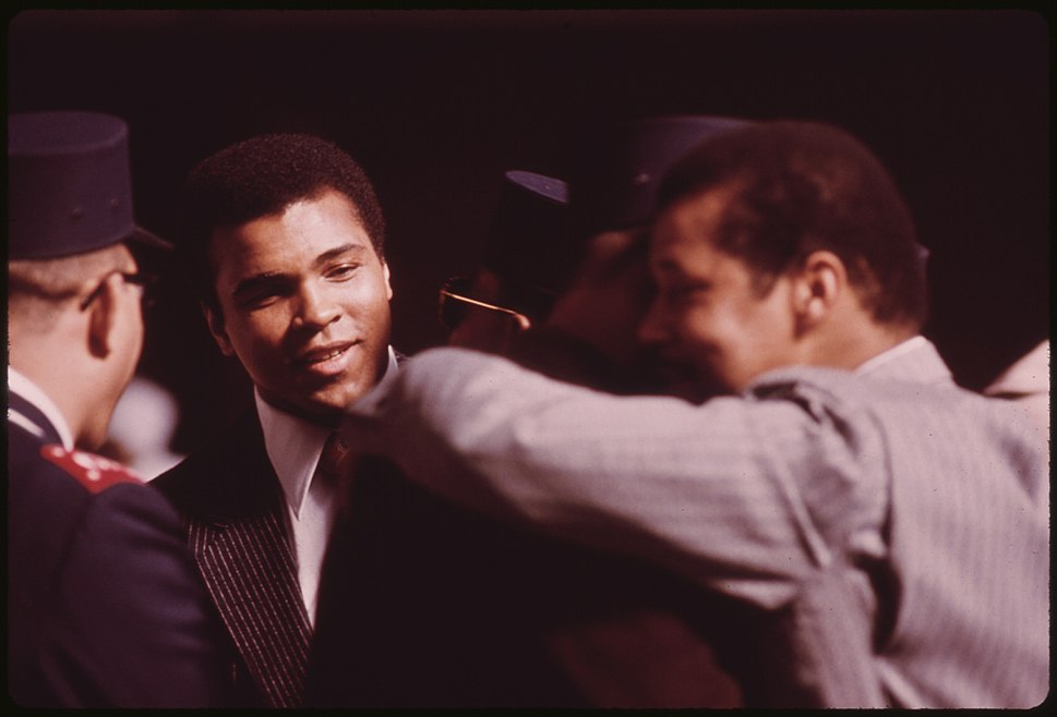 WORLD HEAVYWEIGHT BOXING CHAMPION MUHAMMAD ALI, A BLACK MUSLIM, ATTENDS THE SECT'S SERVICE TO HEAR ELIJAH MUHAMMAD... - NARA - 556247