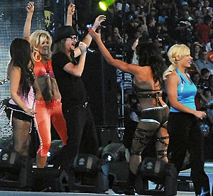 Joy Giovanni - Giovanni (far left (backwards) making her entrance at WrestleMania XXV in April 2009