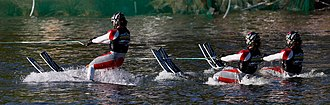 Water skiing - Water skiers rising out of the water