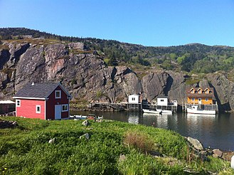 St. John's, Newfoundland and Labrador - Coastline of the Waterside neighbourhood. Some residences, storage shacks, and wharves are primarily made of wood.