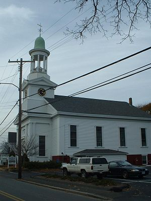 "Wellfleet, Massachusetts - The First Congregational Church of Wellfleet. The clock tower (referred to as ""Town Clock"") is equipped with a ship's signal bell system."