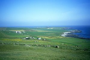 Westray - A view of the western side of the island, with West and East Kirbest in the foreground and Langskaill beyond