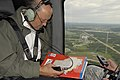 Wisconsin Governor Jim Doyle onboard a UH-60 Blackhawk viewing flood damage.jpg