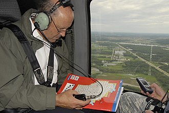 Jim Doyle - Doyle on board a UH-60 Blackhawk viewing 2008 flood damage.