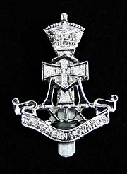 XIX-cap-badge.jpg