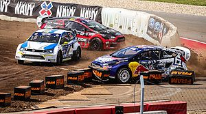 X Games Austin 2014 - Joni Wiman (off track), Toomas Heikkinen (white and blue car) and Nelson Piquet Jr. (red car) in the RallyCross event
