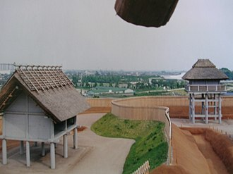 Yoshinogari site - Northern Enclosure showing reconstructed Late Yayoi raised-floor buildings, ditches, and palisades at Yoshinogari