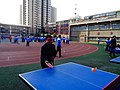 雁塔 陕师大附中分校在打乒乓球 15.jpg