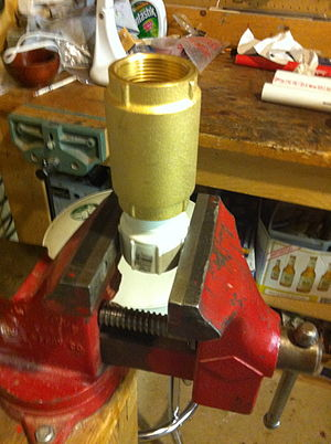 Vise - Light duty homeowner's vise holding a brass check valve.