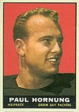 "A color photo of a smiling Paul Hornung, with the text ""Paul Hornung, Halfback, Green Bay Packers"" in a black bar below the photo."