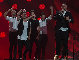 Imri Ziv - Ziv is the first on right, behind Nadav Guedj during the 2015 Eurovision contest