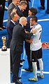 2017 Confederations Cup - Final - Infantino and Mutko award Draxler and Loew.jpg