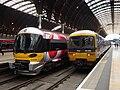 332009 and 166204 at Paddington (12914187345).jpg